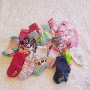 30 pairs of girls socks. 6m to size 24m